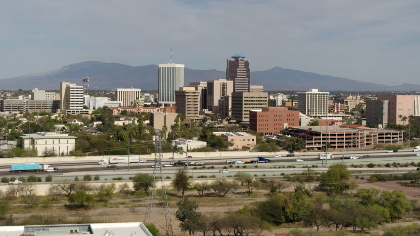 5.7K stock footage aerial video of tall office high-rises and city buildings, seen while approaching I-10, Downtown Tucson, Arizona Aerial Stock Footage | DX0002_144_040
