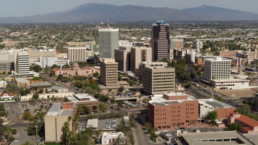 5.7K stock footage aerial video flyby tall office high-rises and city buildings, then descend, Downtown Tucson, Arizona Aerial Stock Footage | DX0002_144_041