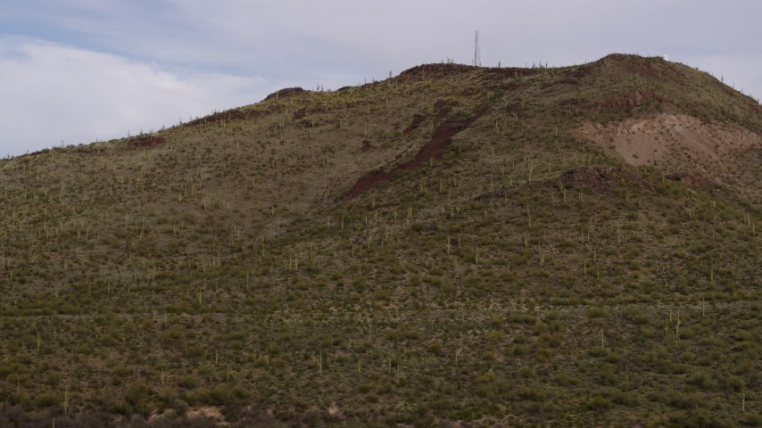 5.7K stock footage aerial video approach Sentinel Peak with cactus plants and radio tower in Tucson, Arizona Aerial Stock Footage | DX0002_145_009
