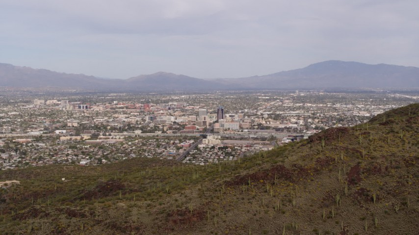 5.7K stock footage aerial video the city of Tucson seen from Sentinel Peak, Arizona Aerial Stock Footage DX0002_145_011 | Axiom Images