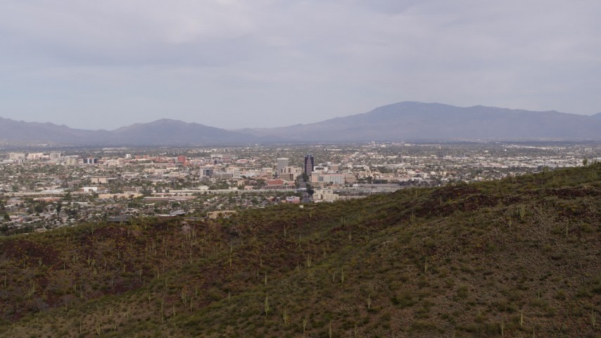 5.7K stock footage aerial video the city of Tucson seen while descending behind Sentinel Peak, Arizona Aerial Stock Footage | DX0002_145_012
