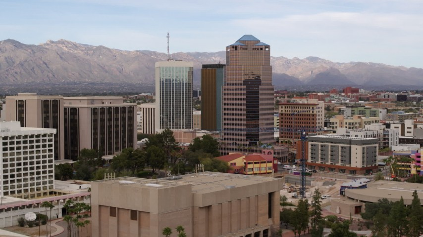 5.7K stock footage aerial video orbit and fly away from the One South Church office high-rise, Downtown Tucson, Arizona Aerial Stock Footage | DX0002_145_018