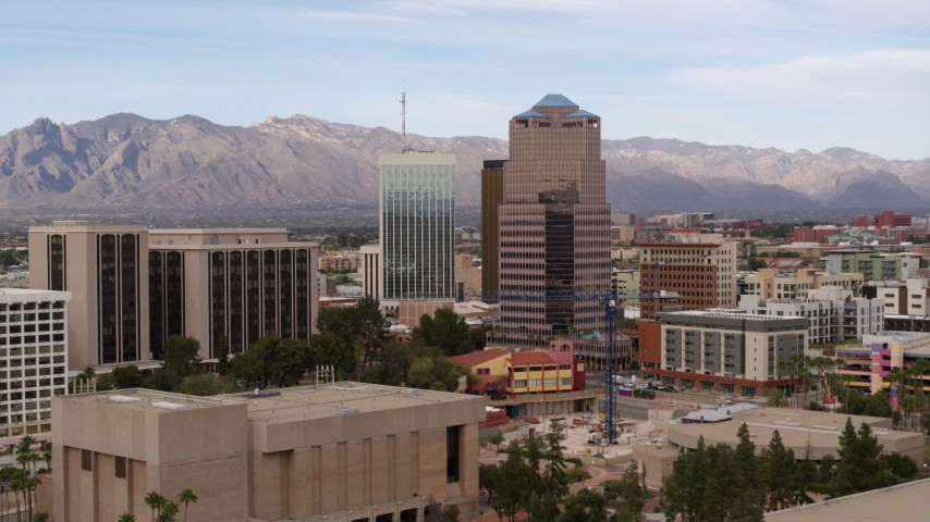 5.7K stock footage aerial video ascend and orbit the One South Church office high-rise, Downtown Tucson, Arizona Aerial Stock Footage DX0002_145_019 | Axiom Images