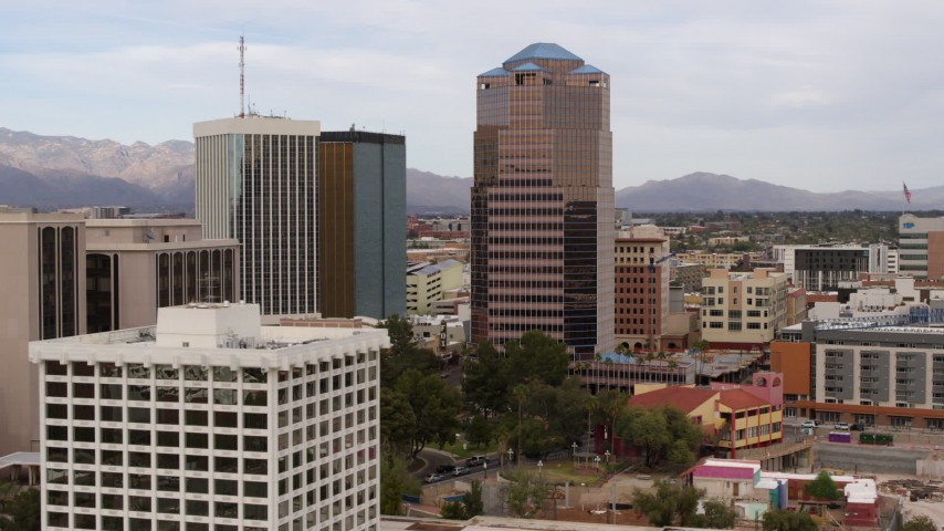 5.7K stock footage aerial video descend and orbit the One South Church office high-rise, Downtown Tucson, Arizona Aerial Stock Footage | DX0002_145_020