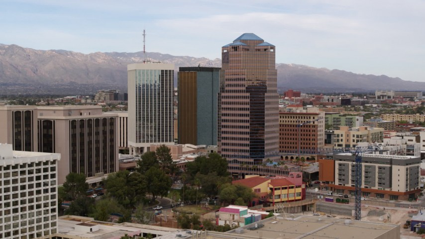 5.7K stock footage aerial video a reverse view of the One South Church office high-rise, Downtown Tucson, Arizona Aerial Stock Footage | DX0002_145_021