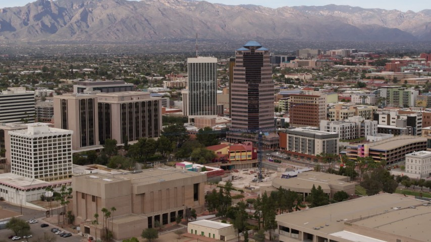 5.7K stock footage aerial video reverse view of courthouse and office high-rises, Downtown Tucson, Arizona Aerial Stock Footage | DX0002_145_022