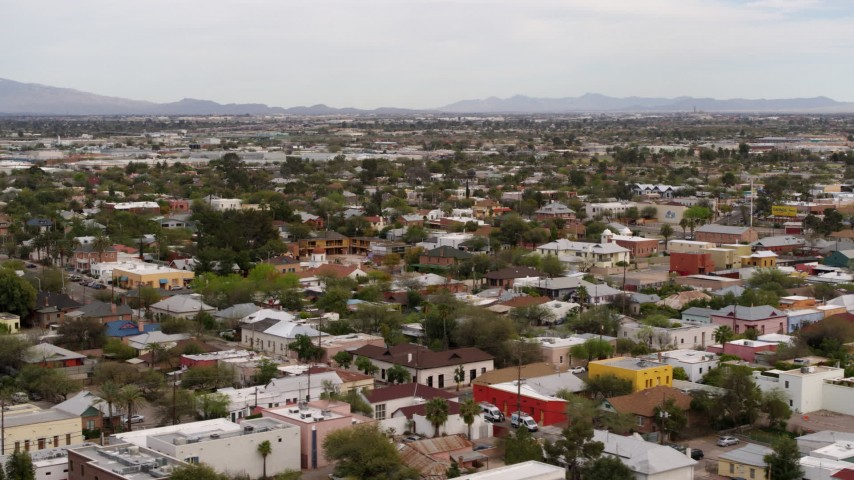 5.7K stock footage aerial video orbit and fly away from an urban neighborhood in Tucson, Arizona Aerial Stock Footage | DX0002_145_025