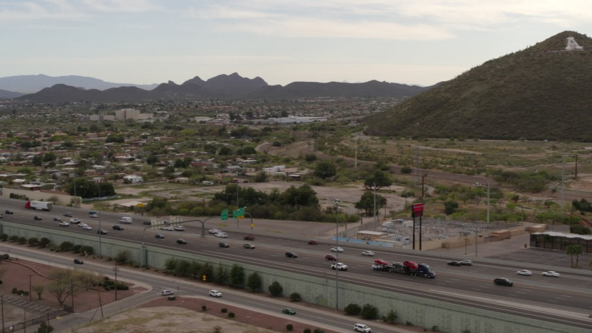 5.7K stock footage aerial video pan across I-10 freeway to reveal Sentinel Peak in Tucson, Arizona Aerial Stock Footage | DX0002_145_026