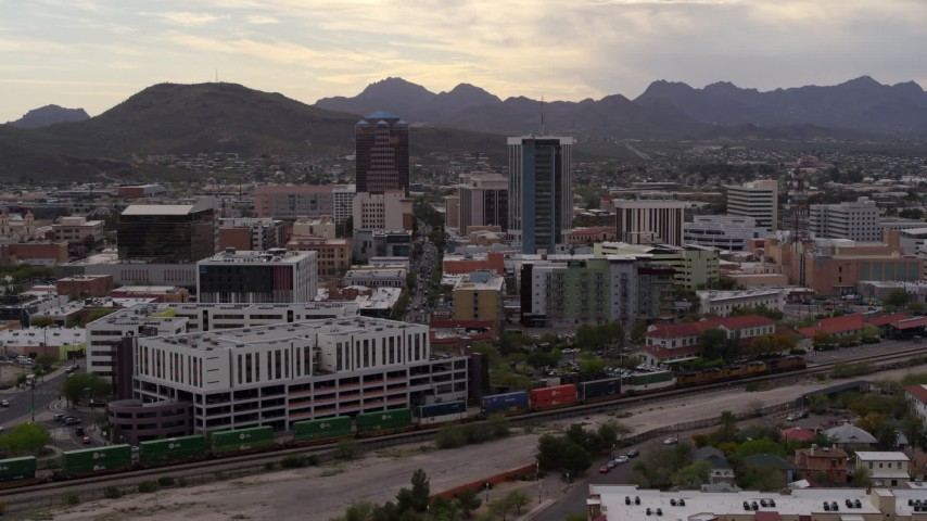5.7K stock footage aerial video of flying away from office towers with Sentinel Peak in the background, Downtown Tucson, Arizona Aerial Stock Footage | DX0002_145_035
