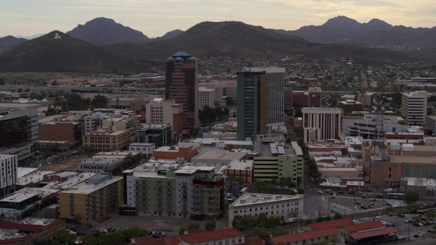 5.7K stock footage aerial video ascend while flying away from office towers, Sentinel Peak in distance, Downtown Tucson, Arizona Aerial Stock Footage DX0002_145_041