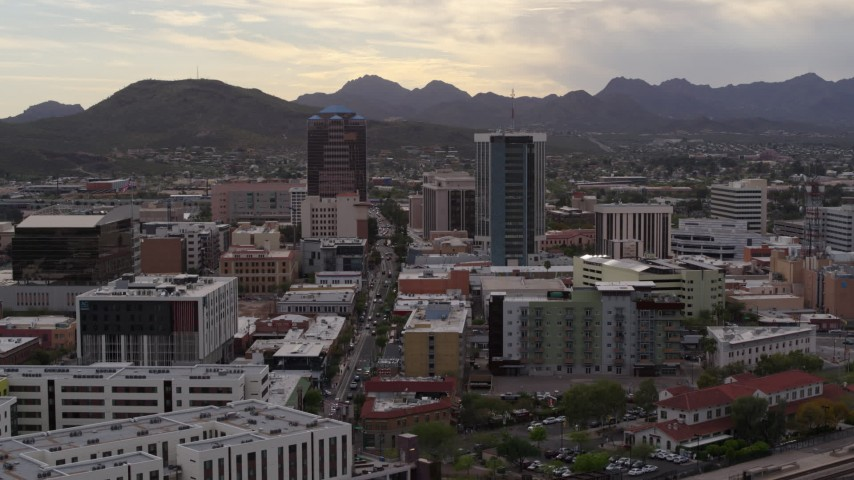 5.7K stock footage aerial video ascend for view of Congress Street between office towers in Downtown Tucson, Arizona Aerial Stock Footage | DX0002_145_043