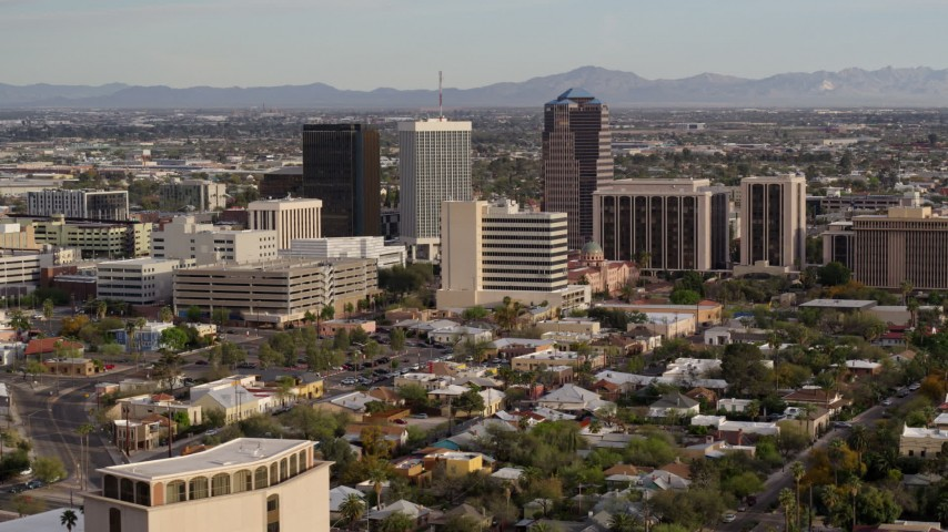 5.7K stock footage aerial video flyby and then approach three office towers in the middle of Downtown Tucson, Arizona Aerial Stock Footage | DX0002_146_003