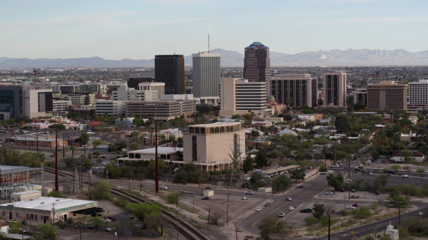 5.7K stock footage aerial video approach three office towers behind university office building in Downtown Tucson, Arizona Aerial Stock Footage | DX0002_146_007