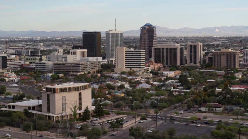 5.7K stock footage aerial video slowly fly away from three office towers in Downtown Tucson, Arizona Aerial Stock Footage | DX0002_146_010