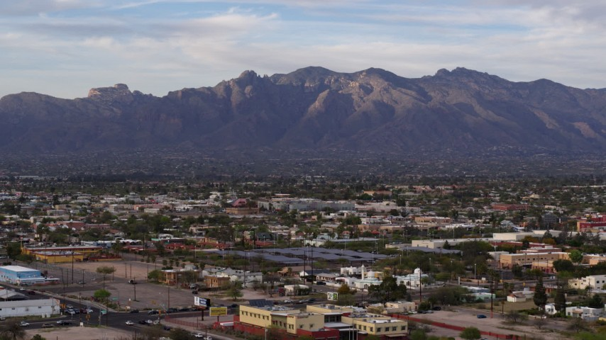 5.7K stock footage aerial video of the Santa Catalina Mountains seen from Tucson, Arizona Aerial Stock Footage DX0002_146_011 | Axiom Images