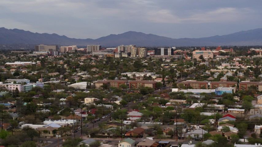 5.7K stock footage aerial video of university buildings behind residential neighborhood, Tucson, Arizona Aerial Stock Footage | DX0002_146_013