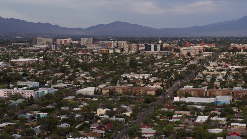5.7K stock footage aerial video of university buildings beyond a residential neighborhood, Tucson, Arizona Aerial Stock Footage | DX0002_146_014