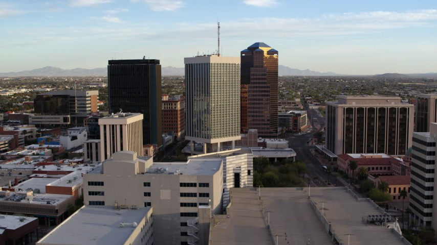5.7K stock footage aerial video of circling the three office towers in Downtown Tucson, Arizona Aerial Stock Footage DX0002_146_019 | Axiom Images