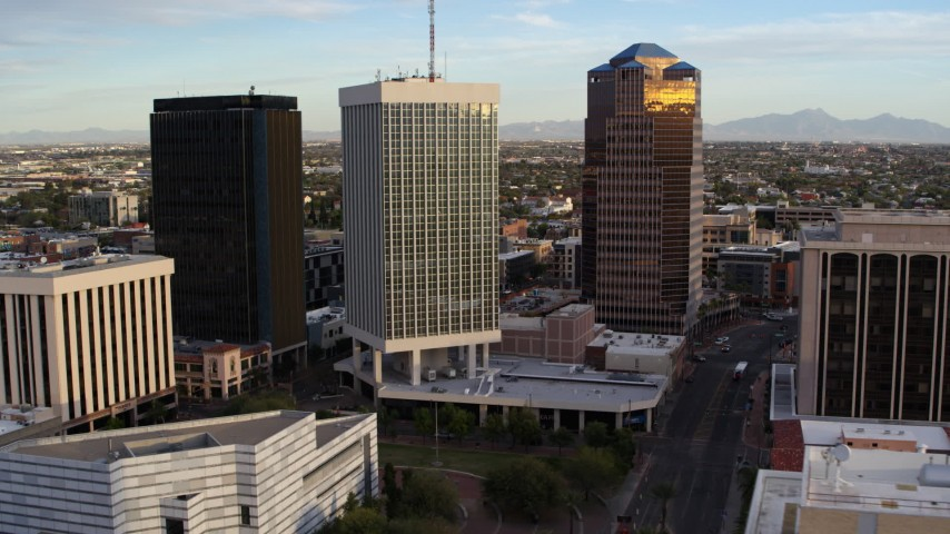 5.7K stock footage aerial video fly away from Bank of America Plaza office tower in Downtown Tucson, Arizona Aerial Stock Footage | DX0002_146_021