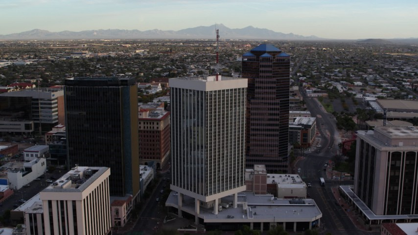 5.7K stock footage aerial video orbit and fly away from Bank of America Plaza office tower in Downtown Tucson, Arizona Aerial Stock Footage | DX0002_146_024
