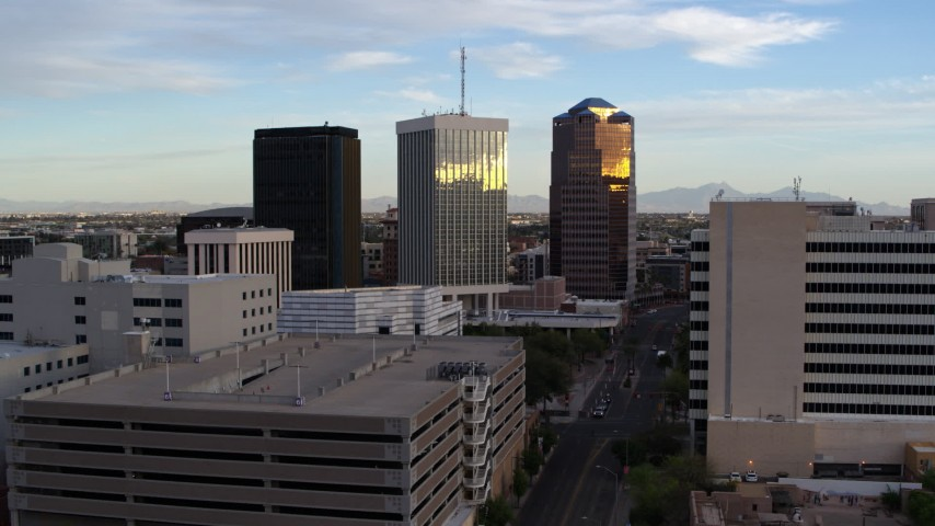 5.7K stock footage aerial video of Bank of America Plaza and neighboring office towers during decent in Downtown Tucson, Arizona Aerial Stock Footage | DX0002_146_026