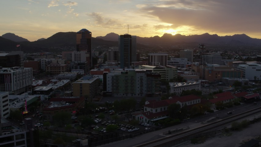 5.7K stock footage aerial video of passing office towers at sunset in Downtown Tucson, Arizona Aerial Stock Footage | DX0002_146_028