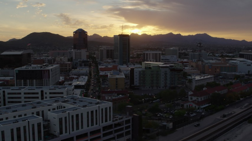 5.7K stock footage aerial video flying away from office towers at sunset in Downtown Tucson, Arizona Aerial Stock Footage | DX0002_146_029