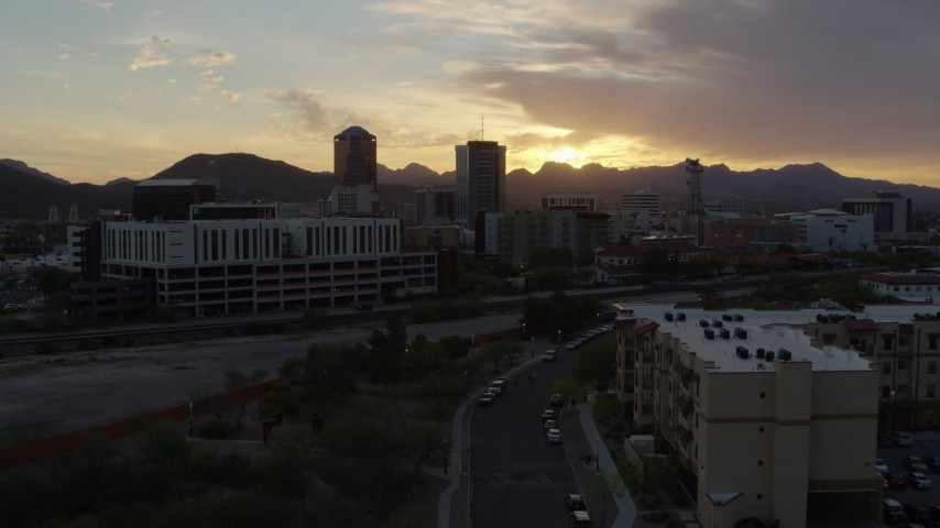 5.7K stock footage aerial video flying away from tall office towers at sunset in Downtown Tucson, Arizona Aerial Stock Footage | DX0002_146_030