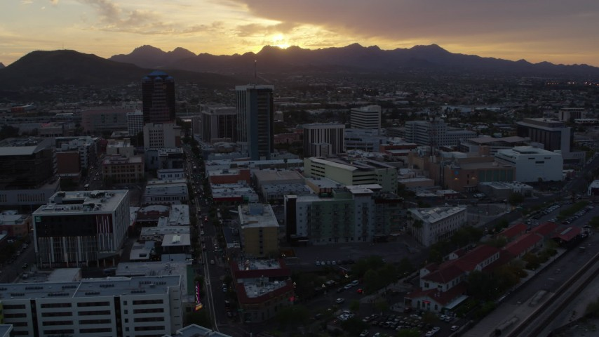 5.7K stock footage aerial video a view of tall office towers and city buildings with view of setting sun in Downtown Tucson, Arizona Aerial Stock Footage DX0002_146_034 | Axiom Images