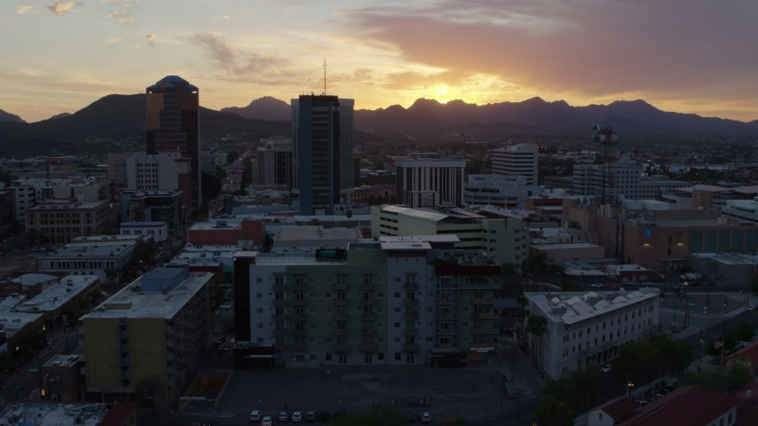 5.7K stock footage aerial video approach and flyby high-rise office towers and setting sun in Downtown Tucson, Arizona Aerial Stock Footage | DX0002_146_039