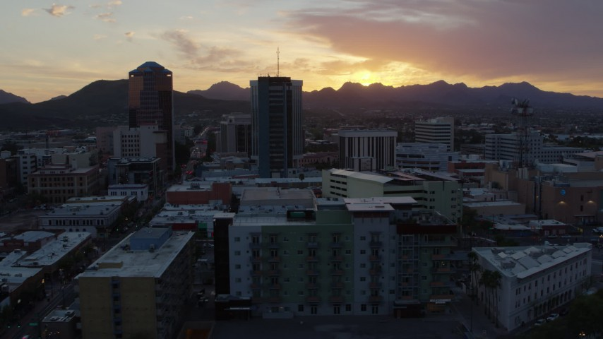 5.7K stock footage aerial video orbit and fly away from high-rise office towers and setting sun in Downtown Tucson, Arizona Aerial Stock Footage | DX0002_146_040