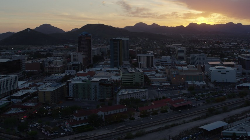5.7K stock footage aerial video of high-rise office towers and Sentinel Peak at sunset in Downtown Tucson, Arizona Aerial Stock Footage | DX0002_146_042