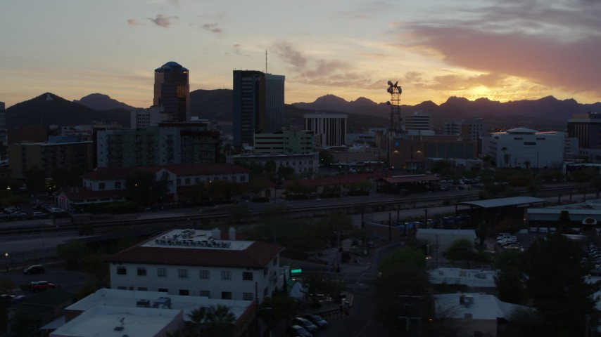 5.7K stock footage aerial video focusing on high-rise office towers and city buildings at sunset in Downtown Tucson, Arizona Aerial Stock Footage | DX0002_146_045