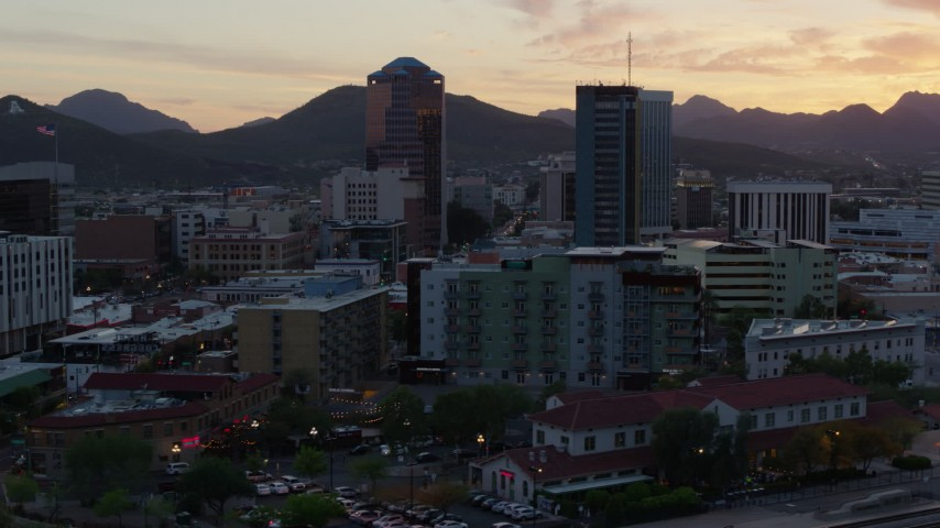 5.7K stock footage aerial video focusing on high-rise office towers at sunset in Downtown Tucson, Arizona Aerial Stock Footage | DX0002_147_001