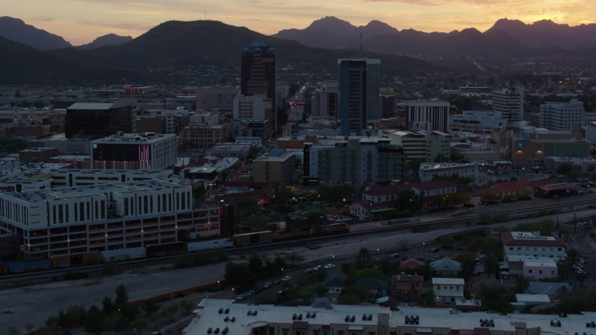 5.7K stock footage aerial video focusing on high-rise office towers at sunset while ascending, Downtown Tucson, Arizona Aerial Stock Footage | DX0002_147_004