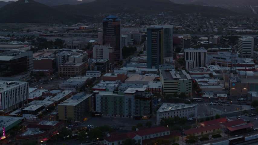 5.7K stock footage aerial video flying by high-rise office towers at sunset with Sentinel Peak in distance, Downtown Tucson, Arizona Aerial Stock Footage | DX0002_147_005