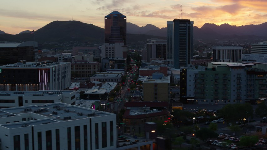 5.7K stock footage aerial video of high-rise office towers at sunset with mountains in distance, Downtown Tucson, Arizona Aerial Stock Footage | DX0002_147_007