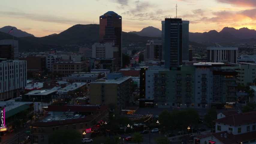5.7K stock footage aerial video approach and orbit high-rise office towers at sunset with mountains in distance, Downtown Tucson, Arizona Aerial Stock Footage | DX0002_147_009