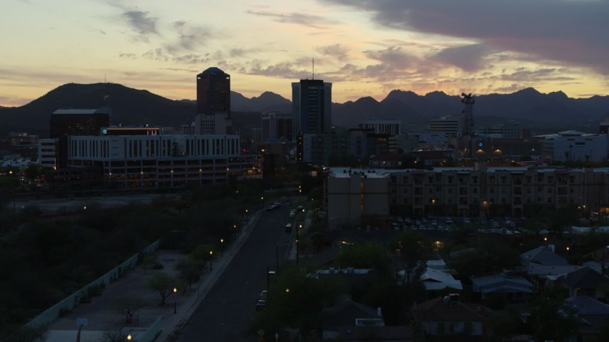 5.7K stock footage aerial video low approach to office towers at sunset, seen from apartment buildings, Downtown Tucson, Arizona Aerial Stock Footage DX0002_147_015 | Axiom Images