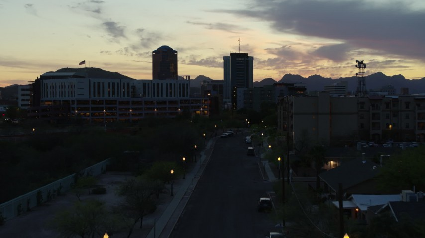 5.7K stock footage aerial video ascend toward office towers at sunset, seen from apartment buildings, Downtown Tucson, Arizona Aerial Stock Footage DX0002_147_016 | Axiom Images