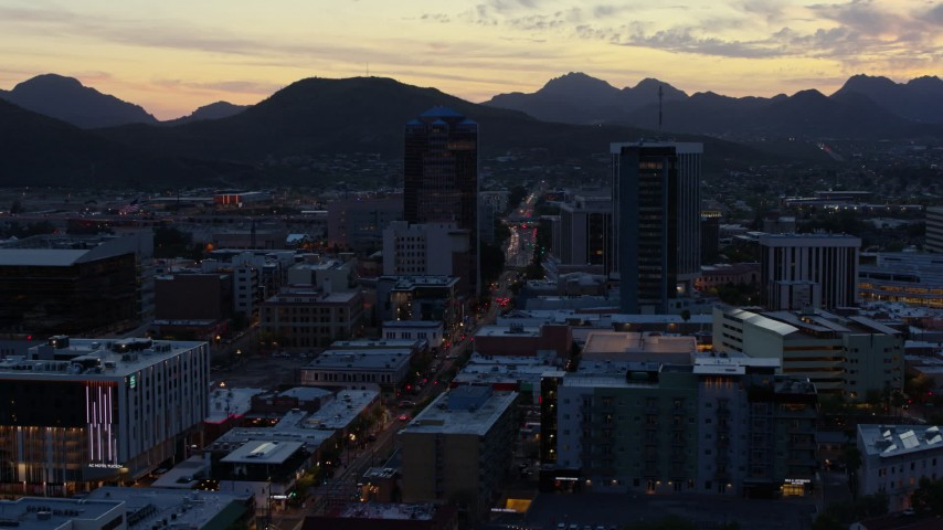 5.7K stock footage aerial video office towers at sunset, seen while ascending, Downtown Tucson, Arizona Aerial Stock Footage | DX0002_147_017