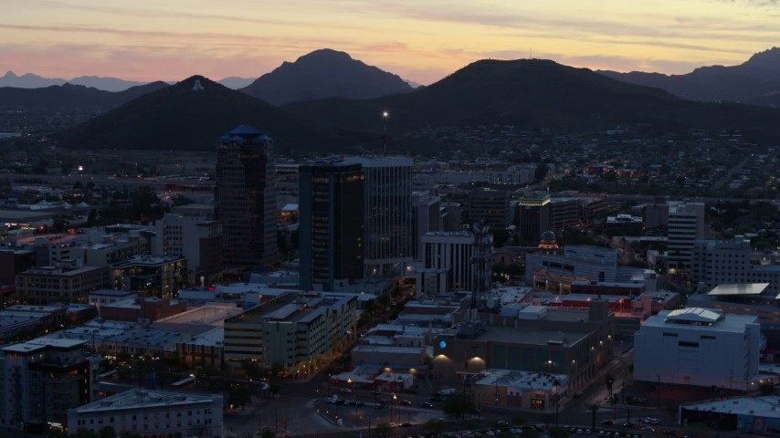 5.7K stock footage aerial video tall office towers at sunset, Sentinel Peak in the distance, Downtown Tucson, Arizona Aerial Stock Footage | DX0002_147_018