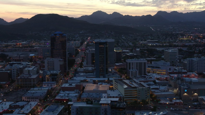 5.7K stock footage aerial video focus on tall office towers at sunset while flying by Downtown Tucson, Arizona Aerial Stock Footage | DX0002_147_020