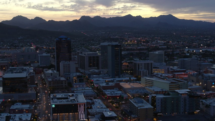 5.7K stock footage aerial video reverse view and flyby tall office towers at sunset, Downtown Tucson, Arizona Aerial Stock Footage | DX0002_147_021
