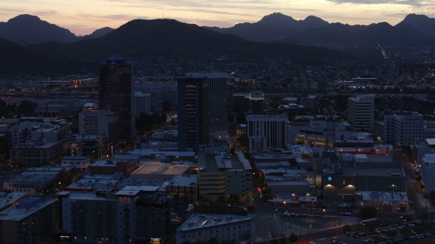 5.7K stock footage aerial video slowly approach and flyby tall office towers at sunset, Downtown Tucson, Arizona Aerial Stock Footage | DX0002_147_022