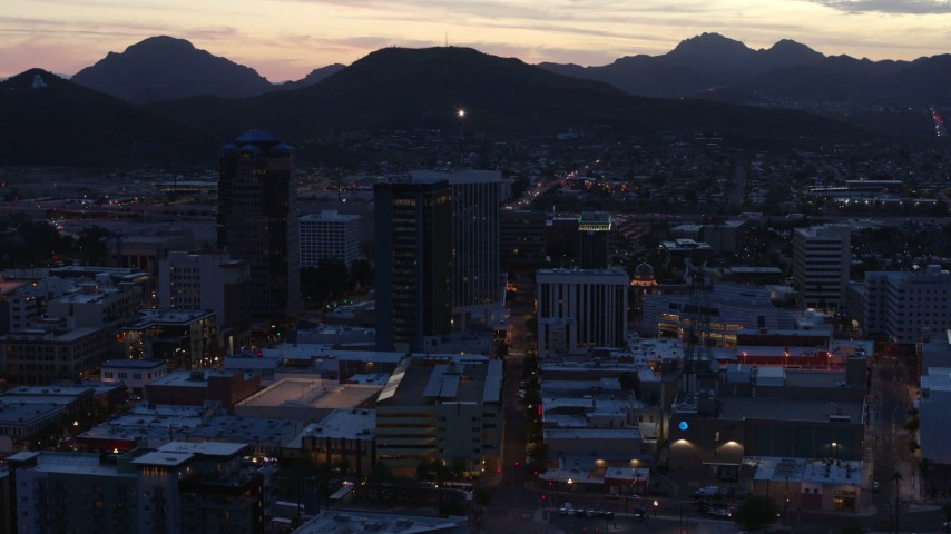 5.7K stock footage aerial video slowly passing tall office towers at sunset, Downtown Tucson, Arizona Aerial Stock Footage DX0002_147_023 | Axiom Images