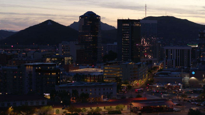 5.7K stock footage aerial video slowly orbit tall office towers at sunset, Downtown Tucson, Arizona Aerial Stock Footage | DX0002_147_025