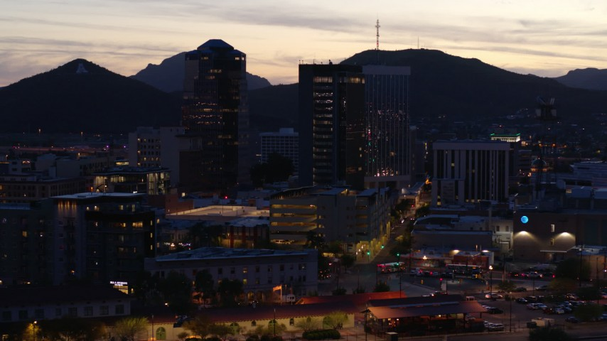 5.7K stock footage aerial video slowly circling tall office towers at sunset, Downtown Tucson, Arizona Aerial Stock Footage | DX0002_147_026