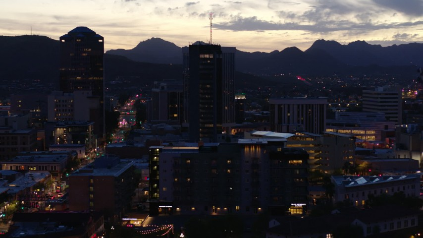 5.7K stock footage aerial video orbiting tall office towers at sunset, Downtown Tucson, Arizona Aerial Stock Footage | DX0002_147_027