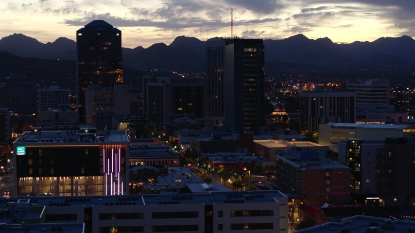 5.7K stock footage aerial video orbit tall office towers and Congress Street at sunset, Downtown Tucson, Arizona Aerial Stock Footage | DX0002_147_028
